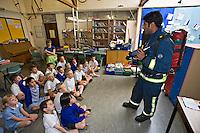 Firefighters with schoolchildren