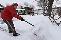 SNOW ROUND 2<br />Ron Sommers, 80 shovels his driveway on Wednesday Feb. 17 2021  in the Larue community on Beaver Lake in east Benton County after another round of snow. Sommers and his wife, Gloria, planned to spread play sand mixed with epsom salt on the drive after shoveling. The Sommers measured about 4 inches of snow at their home. Go to nwaonline.com/210218Daily/ to see more photos.<br />(NWA Democrat-Gazette/Flip Putthoff)