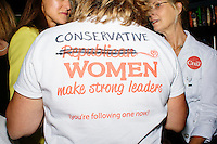 """A woman wears a shirt reading """"Conservative Women make strong leaders"""" with the word """"Republican"""" crossed out before Texas senator and Republican presidential candidate Ted Cruz speaks to a crowd at aa business round-table at the Draft Sports Bar and Grille in Concord, New Hampshire."""