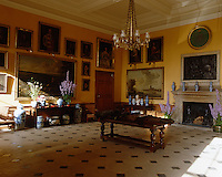 The entrance hall to Petworth House has a stone-flagged floor