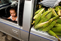 A child watches passers-by as his parents sell corn from the back of a pick-up truck in the markets of Petatlan, in the state of Guerrero, Mexico, which is about 30 minutes from Zihuatanejo/Ixtapa. . .. (Photos taken August 2007) PHOTOS BY: PATRICK SCHNEIDER PHOTO.COM