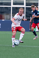 FOXBOROUGH, MA - JUNE 26: Derek Waldeck #18 of North Texas SC pases the ball forward during a game between North Texas SC and New England Revolution II at Gillette Stadium on June 26, 2021 in Foxborough, Massachusetts.