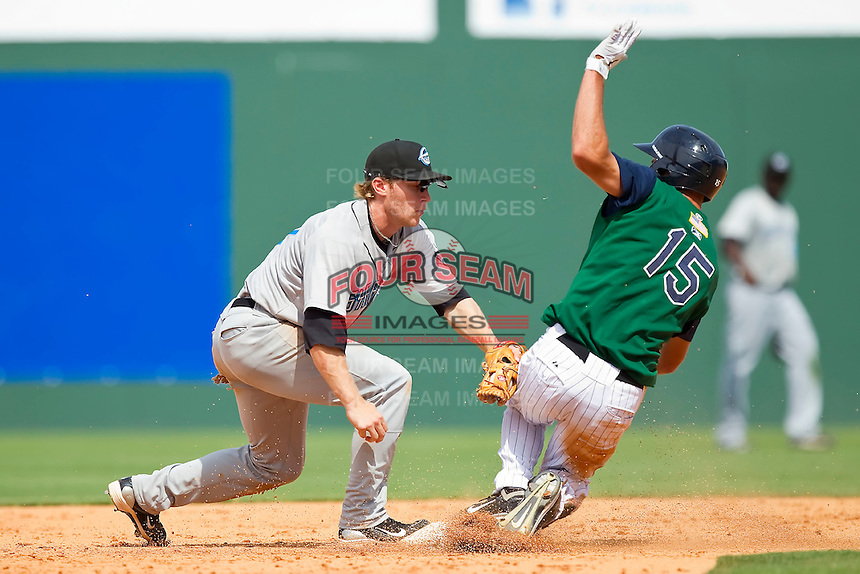 Second baseman Matt Antonelli #17 of the Syracuse Chiefs applies a late tag as Jordan Danks #15 of the Charlotte Knights slides in with a double at Knights Stadium on June 19, 2011 in Fort Mill, South Carolina.  The Knights defeated the Chiefs 10-9.    (Brian Westerholt / Four Seam Images)