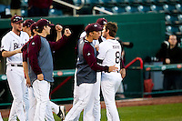 Clay Murphy (8) of the Missouri State Bears is congratulated by teammates after striking out a batter during a game against the Oklahoma State Cowboys at Hammons Field on March 6, 2012 in Springfield, Missouri. (David Welker / Four Seam Images)