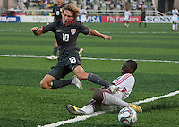 Andrew Craven gets tackled. US Men's National Team Under 17 defeated Malawi 1-0 in the second game of the FIFA 2009 Under-17 World Cup at Sani Abacha Stadium in Kano, Nigeria on October 29, 2009.