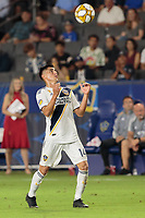 CARSON, CA - SEPTEMBER 15: Joe Corona #14 of the Los Angeles Galaxy heads a ball during a game between Sporting Kansas City and Los Angeles Galaxy at Dignity Health Sports Complex on September 15, 2019 in Carson, California.