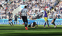 Pictured: Referee Chris Foy (L) the moment he got knocked over by a Fabricio Coloccini of Newcastle (C) deflection from a Jonjo Shelvey (4th L) shot of Swansea. Saturday 19 April 2014<br /> Re: Barclay's Premier League, Newcastle United v Swansea City FC at St James Park, Newcastle, UK.