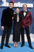 "LONDON, UK. November 11, 2019: Henry Golding, Emelia Clarke and Paul Feig arriving for the ""Last Christmas"" premiere at the BFI Southbank, London.<br /> Picture: Steve Vas/Featureflash"