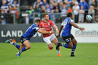 Henry Trinder of Gloucester Rugby offloads as he is tackled by Jamie Roberts of Bath Rugby during the Gallagher Premiership Rugby match between Bath Rugby and Gloucester Rugby at The Recreation Ground on Saturday 8th September 2018 (Photo by Rob Munro/Stewart Communications)