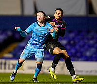 17th February 2021; St Andrews Stadium, Coventry, West Midlands, England; English Football League Championship Football, Coventry City v Norwich City; Callum O'Hare of Coventry City and Max Aarons of Norwich City track the incoming ball into the box