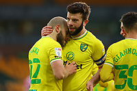 13th February 2021; Carrow Road, Norwich, Norfolk, England, English Football League Championship Football, Norwich versus Stoke City; Teemu Pukki of Norwich City celebrates his goal with Grant Hanley for 4-1 in the 80th minute