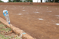 A plastic water  bottle marks the 200 meter mark at the only track in the Kenyan high altitude town of Iten. The town is home to some of the world's fastest runners and is a destination for  runners from Europe,  USA and the Middle East who come to train alongside Kenya's best athletes.