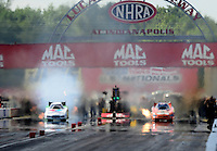 Sept 9, 2012; Clermont, IN, USA: NHRA funny car driver Jack Beckman (left) smokes the tires alongside Todd Lesenko during the US Nationals at Lucas Oil Raceway. Mandatory Credit: Mark J. Rebilas-