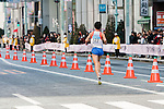 Feb. 27, 2010 - Tokyo, Japan - A runner is seen passing through the Ginza district shortly after the start of the Tokyo Marathon. Some 36,000 runners participated in this fifth edition of the marathon.