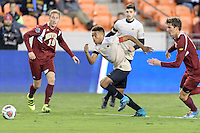 Houston, TX - Friday December 9, 2016: Jacori Hayes (8) of the Wake Forest Demon Deacons races for a loose ball against the Denver Pioneers at the NCAA Men's Soccer Semifinals at BBVA Compass Stadium in Houston Texas.
