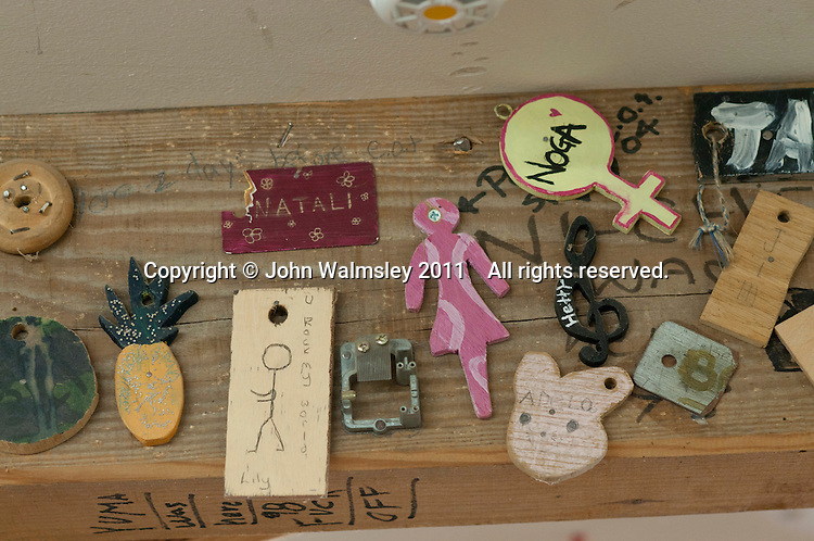 "Individual ""Keys"" made by students for the ""In/Out"" board, carpentry workshop, Summerhill School, Leiston, Suffolk. The school was founded by A.S.Neill in 1921 and is run on democratic lines with each person, adult or child, having an equal say.  You don't have to go to lessons if you don't want to but could play all day.  It gets above average GCSE exam results."
