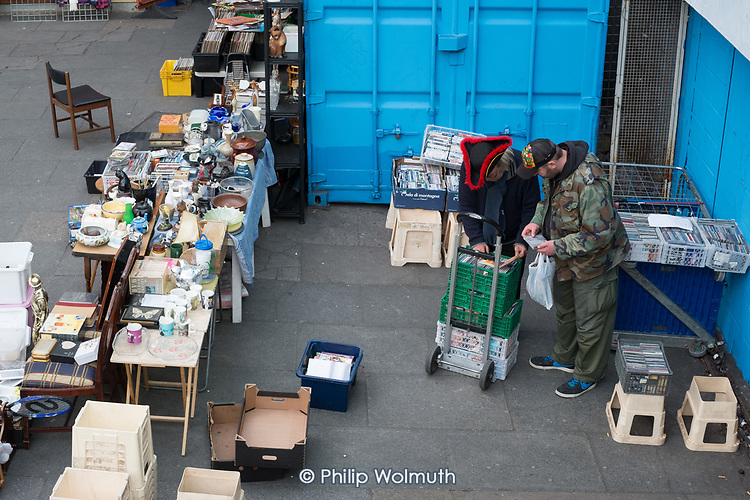 Traders at a bric-a-brac market stall, Elephant & Castle, London.