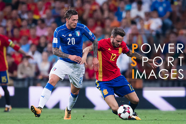 Saul (R) of Spain fights for the ball with Federico Bernardeschi (L) of Italy during their 2018 FIFA World Cup Russia Final Qualification Round 1 Group G match between Spain and Italy on 02 September 2017, at Santiago Bernabeu Stadium, in Madrid, Spain. Photo by Diego Gonzalez / Power Sport Images