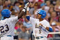 UCLA outfielder Brenton Allen (23) greets teammate Kevin Williams (5) after he score against the Mississippi State Bulldogs during the 2013 Men's College World Series Final on June 25, 2013 at TD Ameritrade Park in Omaha, Nebraska. The Bruins defeated the Bulldogs 8-0, winning the National Championship. (Andrew Woolley/Four Seam Images)