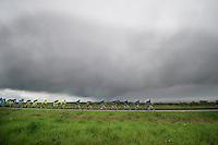 peloton under a dark, grim sky<br /> <br /> Giro d'Italia 2014<br /> stage 2: Belfast-Belfast <br /> 219km