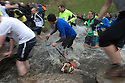 06/11/16<br /> <br /> ***WITH VIDEO***<br /> <br /> Despite temperatures barely rising above freezing around 1,400 crazy runners took on the cross-country challenge of a four-and-a-three-quarter mile run around the iconic Peak District beauty spot of the stepping stones at Dovedale.<br /> <br /> And it wasn't just human runners splashing through the River Dove, several hundred dogs had joined their owners to enjoy the 60th Dovedale Dash, an annual race which sees competitors tackle a circular loop to and from Thorpe. <br /> <br /> The popular race, which attracts many runners in fancy dress, was first run in 1953 but has missed some years due to flooded rivers and muddy pastures.<br /> <br /> All Rights Reserved F Stop Press Ltd. (0)1773 550665   www.fstoppress.com
