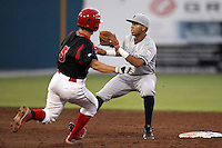 Staten Island Yankees shortstop Cito Culver #2 takes the throw as Casey Rasmus #5 slides in during a game against the Batavia Muckdogs at Dwyer Stadium on July 29, 2011 in Batavia, New York.  Staten Island defeated Batavia 10-7.  (Mike Janes/Four Seam Images)