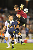 MELBOURNE, AUSTRALIA - FEBRUARY 5, 2010: Aziz Behich from Melbourne Victory collides with Justin Pasfield from North Queensland Fury in round 26 of the A-league match between Melbourne Victory and North Queensland Fury at Etihad Stadium on February 5, 2010 in Melbourne, Australia. Photo Sydney Low www.syd-low.com