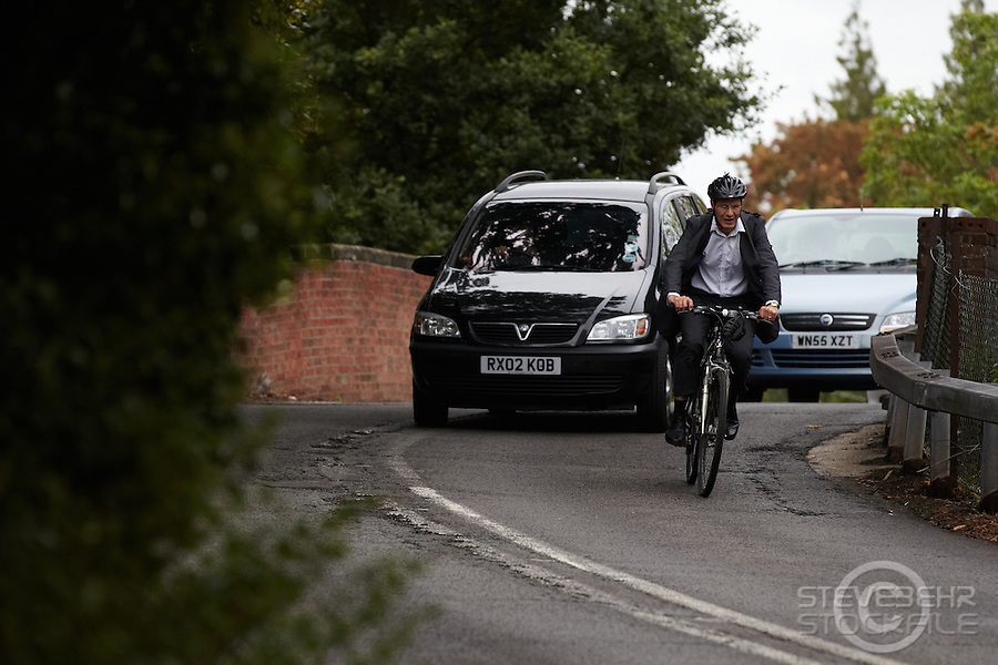 Man commuting by bicycle wearing a suit , Sunningdale , Berkshire , September 2011 pic copyright Steve Behr / Stockfile