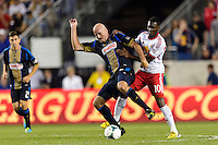 Conor Casey (6) of the Philadelphia Union and Lloyd Sam (10) of the New York Red Bulls. The New York Red Bulls and the Philadelphia Union played to a 0-0 tie during a Major League Soccer (MLS) match at Red Bull Arena in Harrison, NJ, on August 17, 2013.