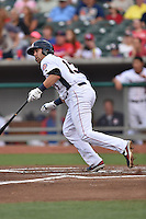 Tennessee Smokies first baseman Dustin Geiger #13 swings at a pitch during a game against the Jacksonville Suns at Smokies Park July 10, 2014 in Kodak, Tennessee. The Suns defeated the Smokies 6-5. (Tony Farlow/Four Seam Images)