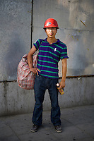 Shidengjiang, a construction worker, age 26, poses for a portrait in Beijing. Response to 'What does China mean to you?': 'China is my own home.'  Response to 'What is your role in China's future?': 'The China of the future will be a place with worldly, forward-thinking people'