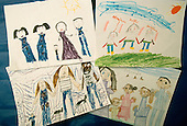 Schenectady, New York.Yates Arts Magnet School / Grade 1 .Drawings of families (includes mixed race and single parent) by four 1st graders. .(Property releases from parents).PN#:29206       FC#:11722-00301.scan from slide.© Ellen B. Senisi