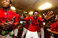 Oscar Taveras (25) of the Springfield Cardinals celebrates in the clubhouse after beating the Tulsa Drillers in the North Division Championship game at Hammons Field on September 9, 2012 in Springfield, Missouri. (David Welker/Four Seam Images)