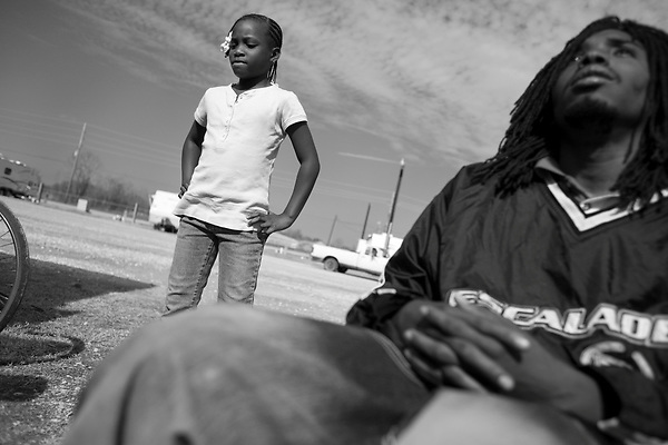 February 02, 2008. Baker, LA.. Renaissance Village trailer park for Louisiana residents displaced by Hurricanes Katrina and Rita. Over 2 years after the storms, hundreds of residents still live in the temporary trailer park, as they search for ways to move out and reestablish their lives.. Adrian Love, 9, and Cearion Bailey. Adrian left the park for 2 weeks for a camp in New Jersey set up by a charity, but is now back at Baker with her father, Alton, who works in Baker but is unable to get the money together to move back to New Orleans.