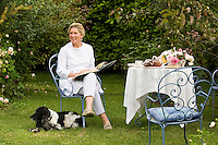 Portrait of Grazia Adamo Giovannetti sitting having afternoon tea in the grounds of her rose garden