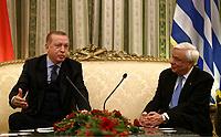 Pictured: Greek President Prokopis Pavlopoulos (R) speaks with Turkey President Recep Tayyip Erdogan in the official Presidential Mansion <br /> Re: Turkey's president Recep Tayyip Erdogan has begun a landmark visit to Greece. Thursday 07 December 2017