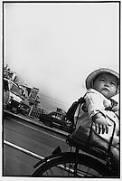 A chubby baby travels peacefully in a baby basket in Beijing...PHOTO BY WANG TONG / SINOPIX