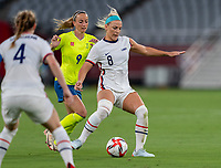 TOKYO, JAPAN - JULY 21: Julie Ertz #8 of the USWNT passes during a game between Sweden and USWNT at Tokyo Stadium on July 21, 2021 in Tokyo, Japan.