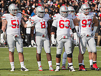 Ohio State defensive players Joel Hale (51), Noah Spence (8), Michael Bennett (63), Joey Bosa (97). The Ohio State Buckeyes defeated the Purdue Boilermakers 56-0 at Ross-Ade Stadium, West Lafayette, Indiana on November2, 2013.
