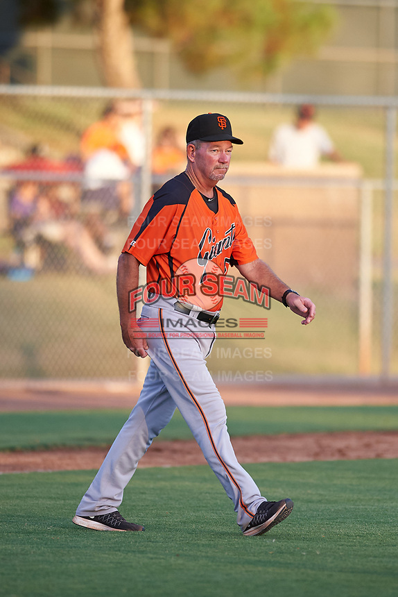 AZL Giants Orange pitching coach Mike Couchee (50) walks toward the mound during an Arizona League game against the AZL Giants Black on July 19, 2019 at the Giants Baseball Complex in Scottsdale, Arizona. The AZL Giants Black defeated the AZL Giants Orange 8-5. (Zachary Lucy/Four Seam Images)