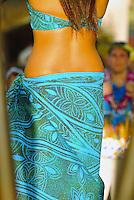 Visitors watch a hula performance at Paradise Cove Luau at Ko Olina, Oahu. Hula is an ancient Hawaiian form of communication.