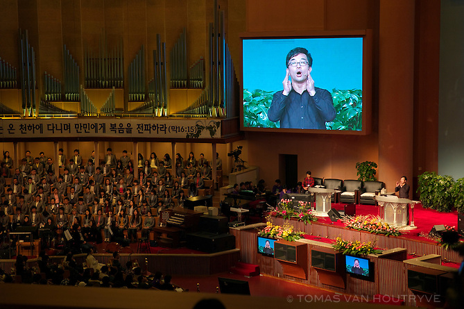 A sermon is delivered with the help of massive television screens at the Yoido Full Gospel Church in Seoul, South Korea on Jan. 29, 2012. The mega church is said to have over 1 million members. Services take place in a church that resembles a stadium.