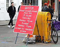 """Coronavirus restriction signs and reminders around London as the capital has been moved from Tier 1 to Tier 2, meaning it is on """"high alert"""" for coronavirus and people must not socialise with others outside their household or support bubble in any indoor setting.<br /> These increased measures are in addition to existing national restrictions on gatherings of more than six people and mandatory closing time for the hospitality industry of 22:00. London October 14th 2020<br /> <br /> Photo by Keith Mayhew"""