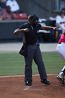Home plate umpire Tre Jester calls a batter out on strikes during the game between the Delmarva Shorebirds and the Pescados de Carolina at Five County Stadium on September 4, 2021 in Zebulon, North Carolina. (Brian Westerholt/Four Seam Images)
