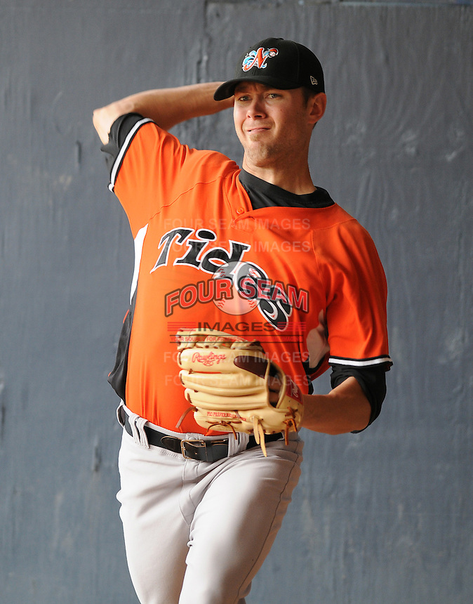 Pitcher Chris Tillman (22) of the Norfolk Tides, International League affiliate of the Baltimore Orioles, prior to a game against the Scranton/Wilkes-Barre Yankees on June 20, 2011, at PNC Park in Moosic, Pennsylvania. (Tom Priddy/Four Seam Images)