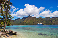 Beach and lagoon with palm trees and a view of an ocean liner and Moorea island mountains (Mount Tohivea) near Tahiti, French Polynesia, Pacific Ocean