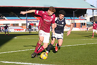 13th March 2021; Dens Park, Dundee, Scotland; Scottish Championship Football, Dundee FC versus Arbroath; Jason Thomson of Arbroath on the ball as Declan McDaid of Dundee tries to shut him down