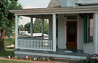 """Augusta:  Porch of house--extends to side. Sign says """"The Almelin"""".   Photo '77."""
