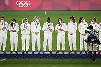 YOKOHAMA, JAPAN - AUGUST 6: The USWNT during the 2020 Tokyo Olympics Women's Soccer medal ceremony at International Stadium Yokohama on August 6, 2021 in Yokohama, Japan.