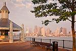 Sunrise view of the Boston skyline from the Harborwalk in Boston, MA